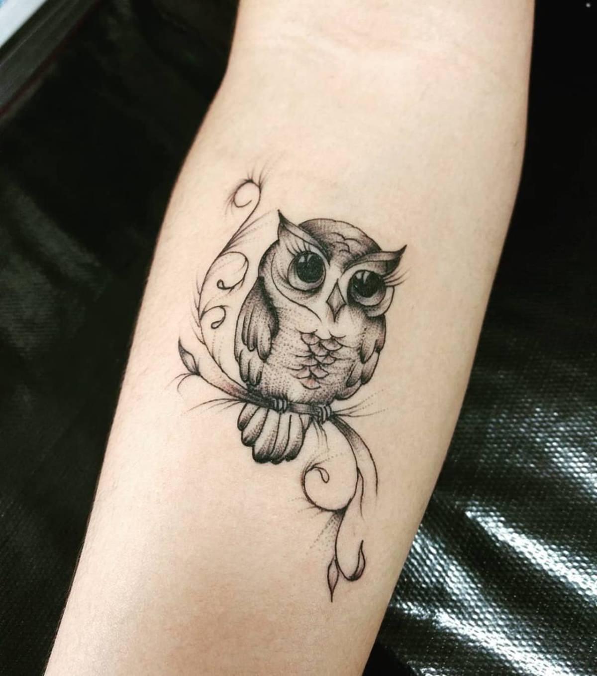 Tatuagem foda de uma coruja